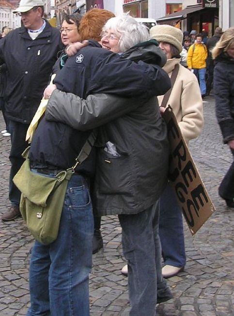 Perfect hug: both arms, smile, eyes closed, joy!
