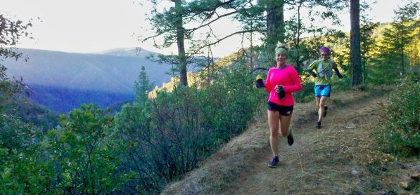 Katie downhilling a not so technical trail. (from iRunFar.com)